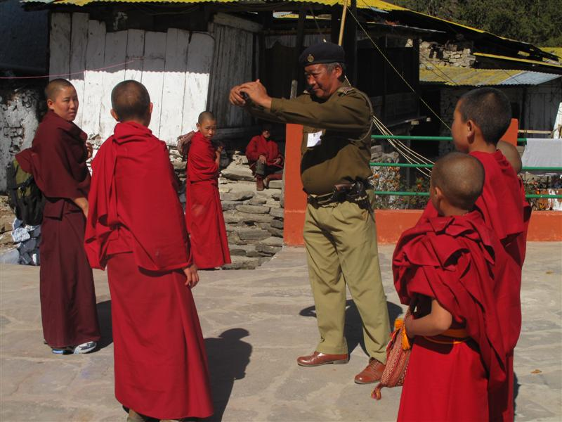 Policeman captures a photo of young monk and Nuns in the Tawang Monastery