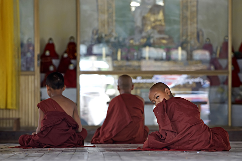 young monks study in one of Mandalay's temples