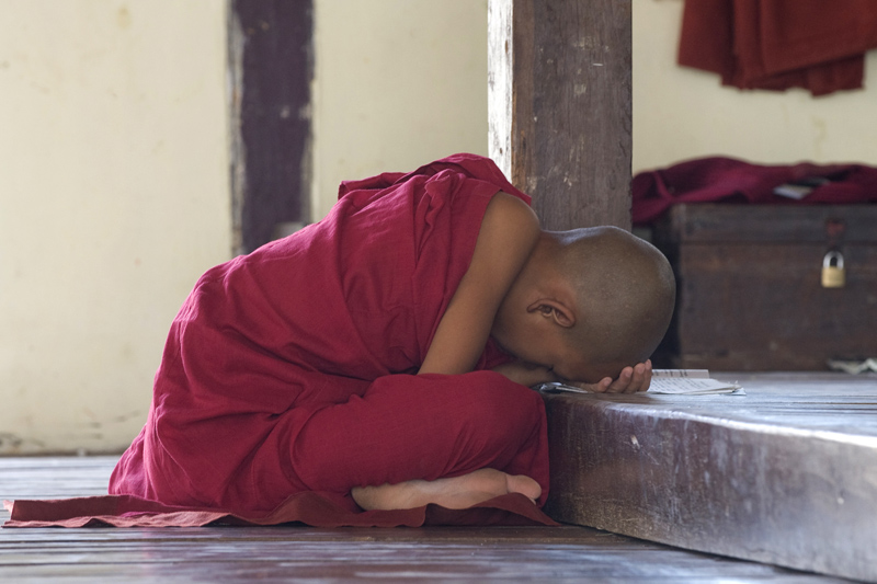 Young monk recites mantras