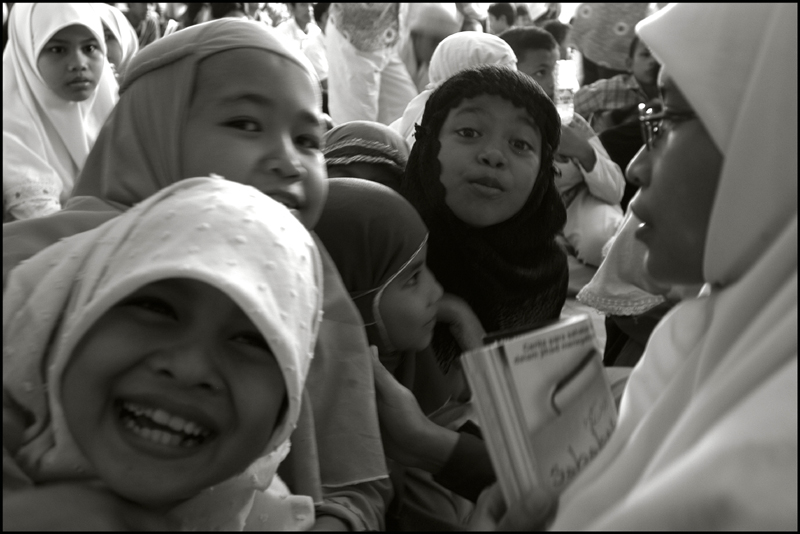 A student (right) from the Fajar Hidayah organization with some girls at an orphanage in Banda Aceh Indonesia