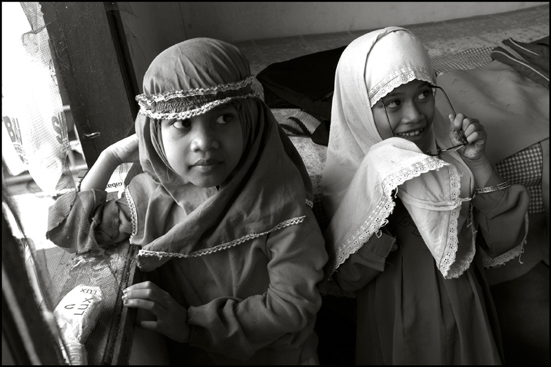 Two young girls just after the midday prayer at an orphanage in Banda Aceh Indonesia