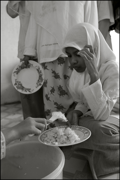 A girl gets her lunch at an orphanage in Banda Aceh Indonesia