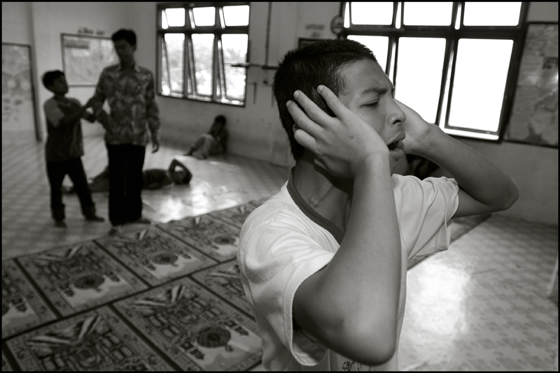 A boy calls out for Allah, just before the boys will do their midday prayer at an orphanage in Banda Aceh Indonesia
