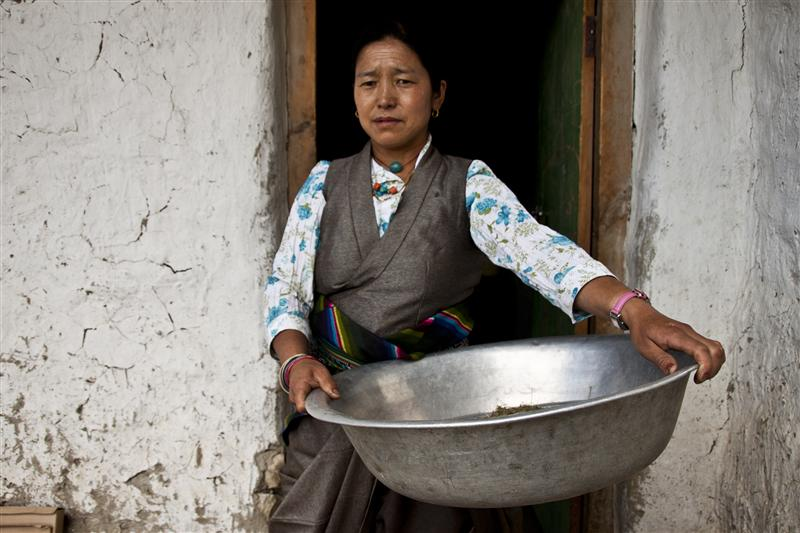 A local woman performing her daily duties in one of the households in Upper Mustang