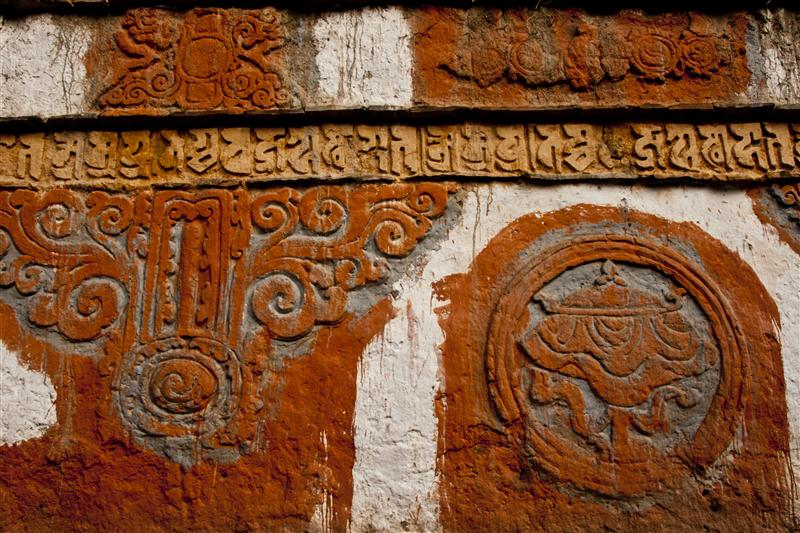 A wall of the monastery that showcases Buddhist textures, showcasing Upper Mustang's richness.