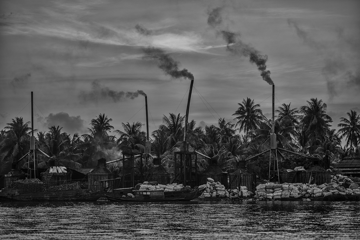 Smoke billows from one of the many factories that repurpose coconut husks