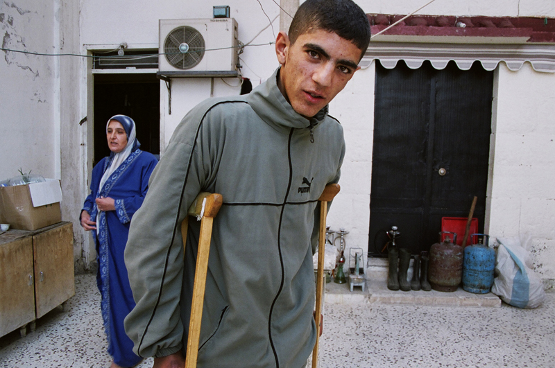 Ali, a cluster bomb victim, with his mother, Aarab Salim, Lebanon