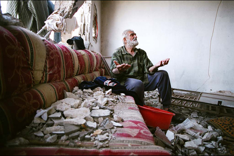 Mustafa inside of his house, Maroun En Ras, Lebanon