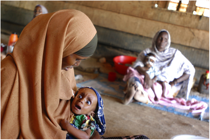 An undernourished girl with her mother at the hospital in IFO refugee camp.