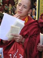A monk read the Dalai Lama's message at the 50th Tibetan Uprising anniversary