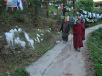 Monk do the holy Kora walk in the backyard of the Dalai Lama Temple.