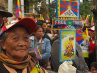 Old Tibetan woman protests