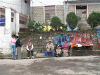 Tibetan Refugees sit along streets outside the Dalai Lama's residence in Dharamsala