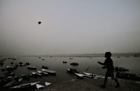 Boy flying Kite on the Ganges Benaras, India, 2009