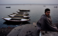 A man meditating (Dhyan) on the ghats of the river Ganges in Benaras.