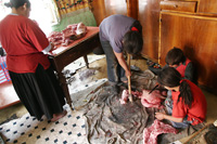 butchering meat inside the kitchen