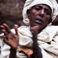 Woman singing during Genna, Lalibela, Ethiopia