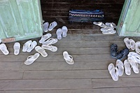 Nurses' flip flops outside the seminar room at Falam Eye Centre