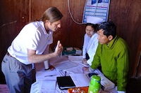 Public health scientist Steve Nygaard collecting data from colleagues at Falam Eye Centre