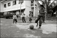 Boys playing football at an orphanage in Banda Aceh Indonesia