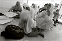 A young girl falls asleep during the English lesson at an orphanage in Banda Aceh Indonesia