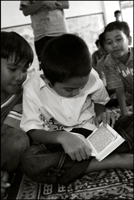 A boy reads the Koran after the midday prayer at an orphanage in Banda Aceh Indonesia