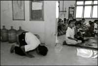 A boy does his prayer in the hall at an orphanage in Banda Aceh Indonesia