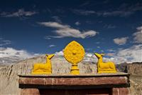 Symbolizes the religious in Tibetan Buddhism, over the Buddhist temple surrounded by mountains.