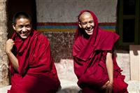 Young monks laugh over a joke made by one of the other monks in the moastic school in Tsarang