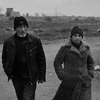 Couple walking to public transport in rural Armenia