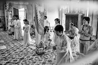 Devotees of the Cao Dai religion pray in their temple